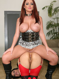 Big meloend redhead domina in red and back stockings has anal fun with small tit
