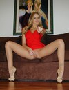Julia Ann in transparent pantyhose spreads her legs wide open and exposes her sh