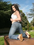 Sassy brunette pornstar peels off her jeans and top to play with her extra big boobs