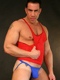 Joey posing in tight blue thongs