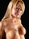 Round titted milf with smooth snatch takes off her corset and thong panties