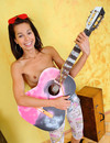Teen girl with pink guitar strips down to her sneakers and exposes her tight smo
