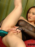 Sexy asian in skin tight transparent dress shows her snatch and plays with flexible dildo