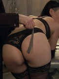 Lovely redhead gets spanked  and loses her black panties after tit torture