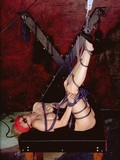 Tied up naked slave woman with ball gag in her mouth gets her legs lifted up