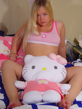 Fatty blonde teen poses on the bed wearing nothing but her pink underwear
