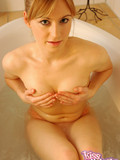 Sweet chick takes a bath with her underwear on and poses in wet clothes