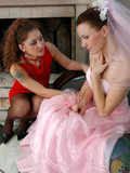 Bride in pink dress and white lingerie has lesbian sexy with lady in red