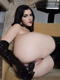 Good looking brunette in black latex boots and gloves shows off her tits and fucks herself