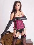 Amazingly sexy domina poses in tempting lingerie and long leather gloves