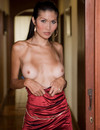 Flirtatious sexy ladyboy bares her tits and post-operation pussy in the door way