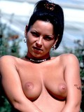 Fully nude latina with puffy nipples and sexy legs exposes her bald snatch outdoors