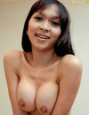 Cute ladyboy with long legs and round tits takes off her dress and underwear