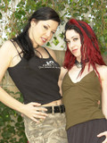 Two lesbian chicks with red and black hair and silky smooth lickable pussies