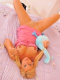 Hot blonde teen Lia with funny ponytails plays in pink babydoll fingering her tight holes