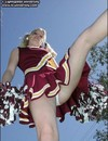 Pigtailed blonde cheerleader in red uniform shows her panties and bare tits in the open air