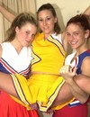 Three playful skinny teen girls in cheerleader uniform show their private parts