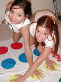 Four naught girls slowly strip when playing a funny game on the floor showing th