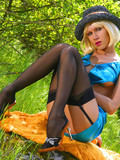 Beautiful blonde gadget getting recorded on the camera in black stockings and hat