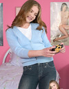 Brown haired girl takes off her jeans and snow white panties in her bedroom