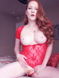 Big titted redhead Lucy O`Hara in sexy outfit plays with her cunt on webcam