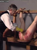 Helpless naked girls with their legs lifted up and fixed get spanked and abused