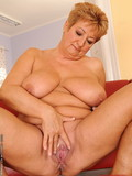 Breasty mature lezzy shows her vagina before she fucks shaved headed chick with strapon