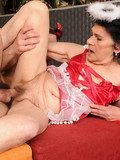 Black haired wrinkled granny in red uniform gets banged by young devil