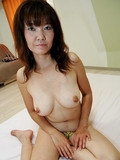 Milfy asian woman displays her natural tits and gets her hairy pussy dicked