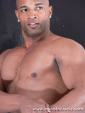 Well built shaved headed black dude gets nude and shows off his muscled body