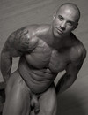 Shaved headed bodybuilder Vin Marco doesn't mind showing his cute piston