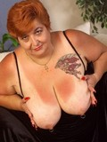 Thick mature licking her big nipples and playing with her extra massive boobs
