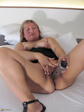 Aged european woman fucks her meaty hairless pussy with good size dildo