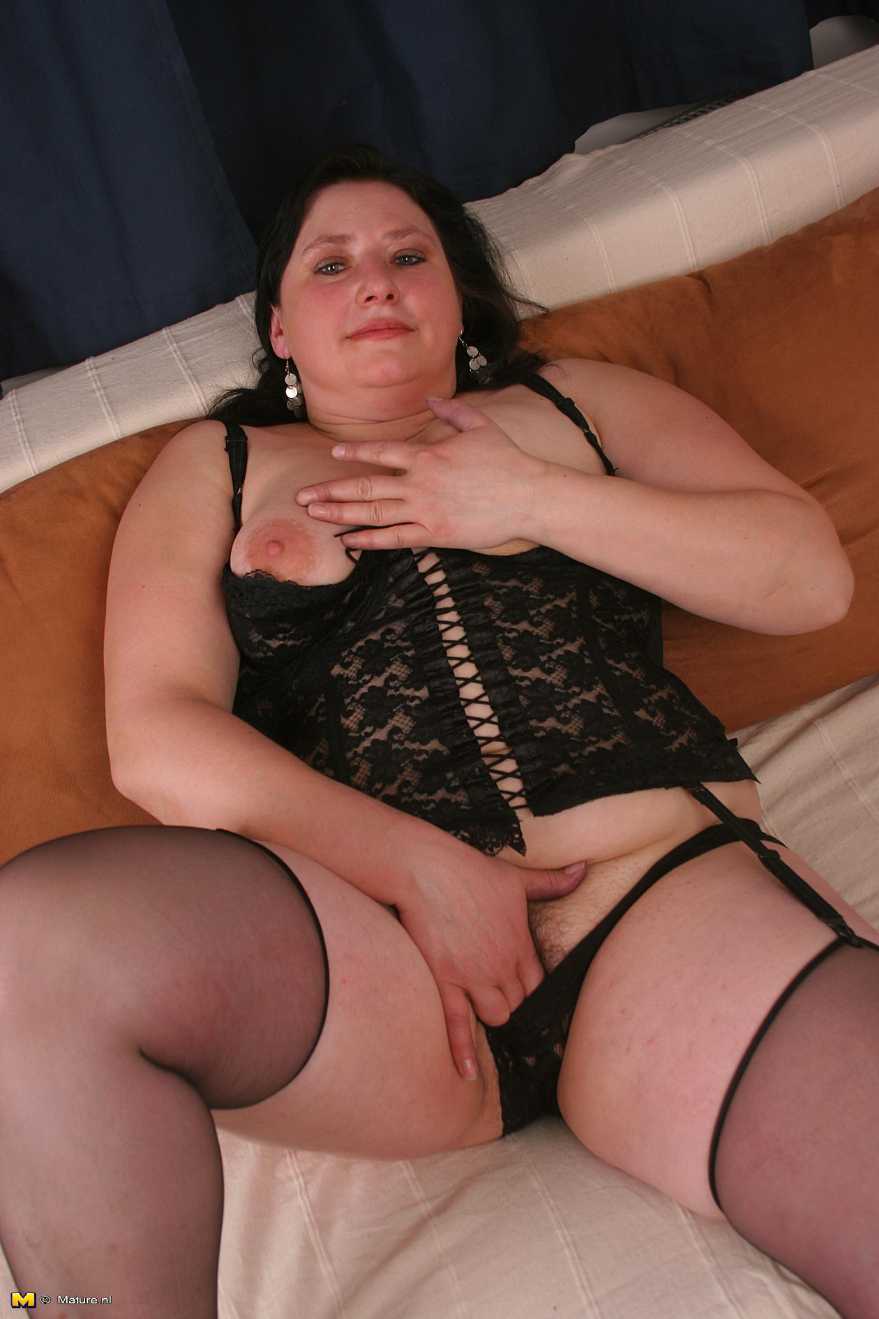 Phrase and mature brunette in a black lingerie can