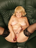Older woman strips down to her black lingerie and plays with her itching pussy