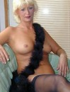 Blonde mature in nothing but stockings and necklet poses showing her amazingly p