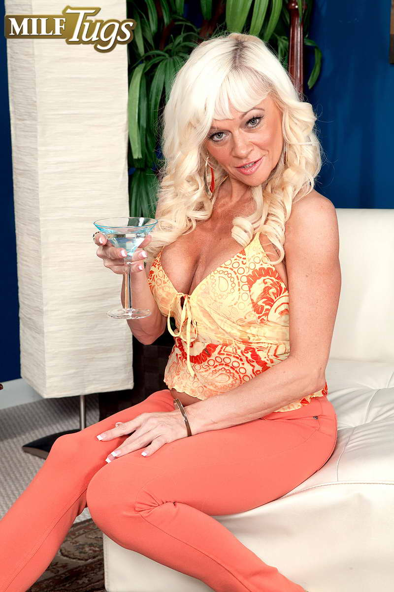 MILFSTUGS Huge titted blonde milf with massive jugs polishes rock hard dick with her experienced hands