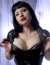 Latex & leather is what raven haired domina Maya Sinstress loves to wear