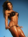 Bikini-clad female bodybuilder over 30 shows off her absolutely amazing body