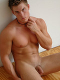 Handsome muscled hunk sitting naked