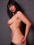 Dark haired mature babe with nice tits poses topless then flashes her bare ass