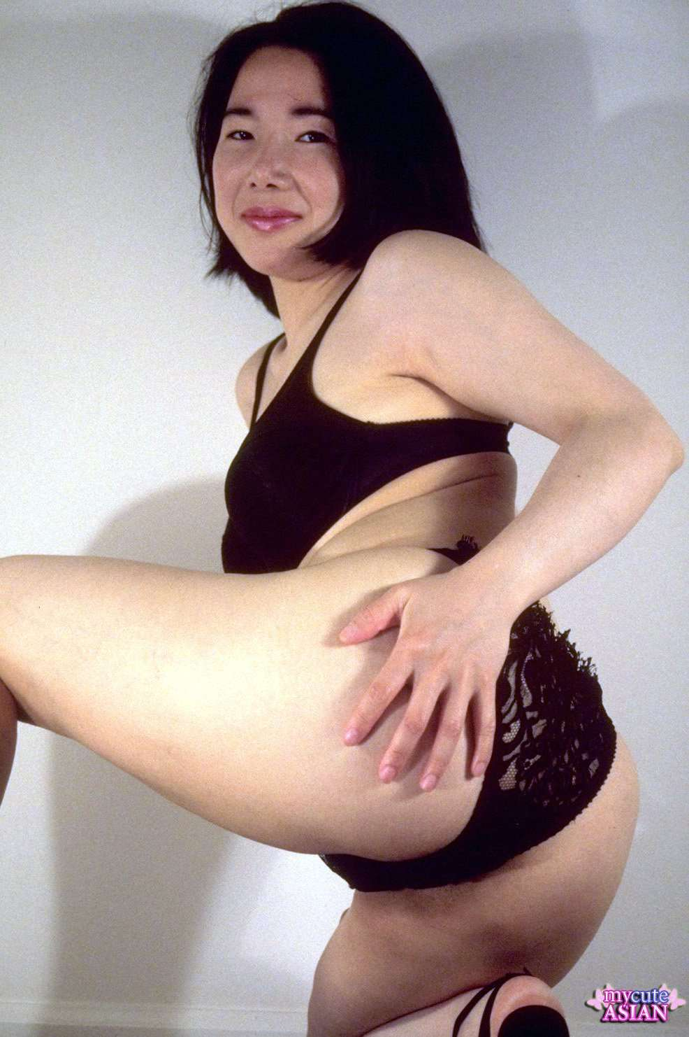 shy looking asian girl with juicy tits gets completely nude and