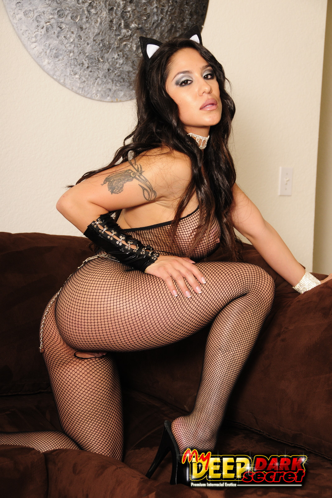 big titted cat girl in sexy fishnet bodystocking takes black meat