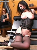 Slave brunette in black stockings and corset gets her pussy and tits tortured