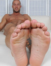 Inked up muscle man Rod Daily strips down to his black socks then exposes his bare feet