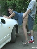Real seduced chick in jean dress and stockings has outdoor sex beside the car