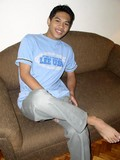 Asian twink poses on the sofa feeling a bit shy then strips and strokes his rod