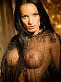 Mysterious brunette pornstar in a black lacy gown shows her big tits and shapely