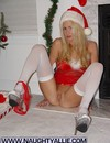 Blonde in white stockings takes off her red lingerie and spreads her legs by the X-mas tree
