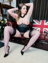 Big tits lady in nylons and heels spreads her legs to show her meaty pussy